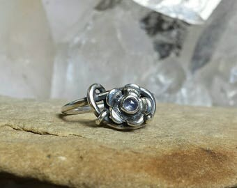 Sterling Silver Daisy ring set with a pale blue Sapphire