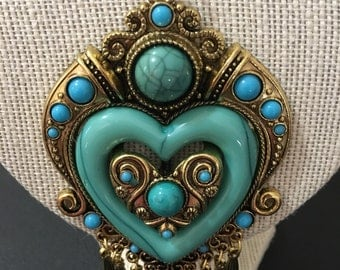 Gold plated chain with a turquoise heart charm