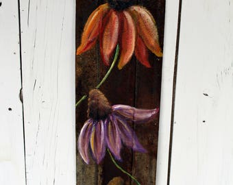 Cone flowers on rusty, corrugated tin