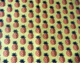 Pineapples on yellow background fabric