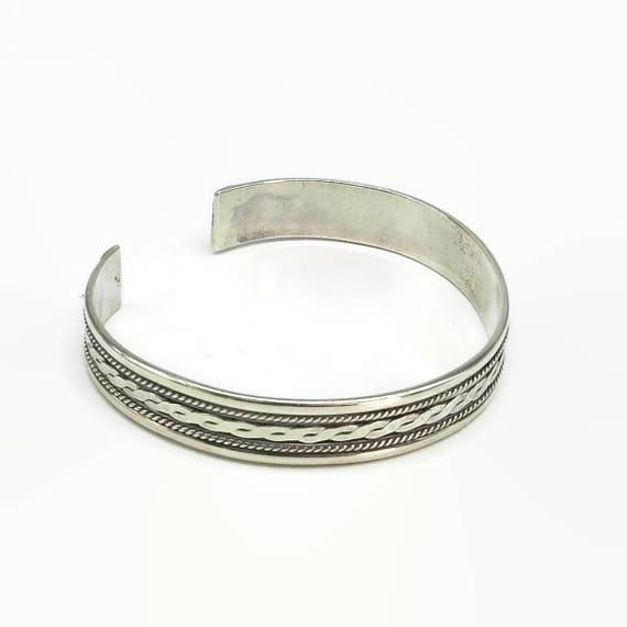 Sterling silver infinity cuff bracelet with beaded borders and row of infinity symbols, open back, adjustable size, 16 grams, circa 1980s