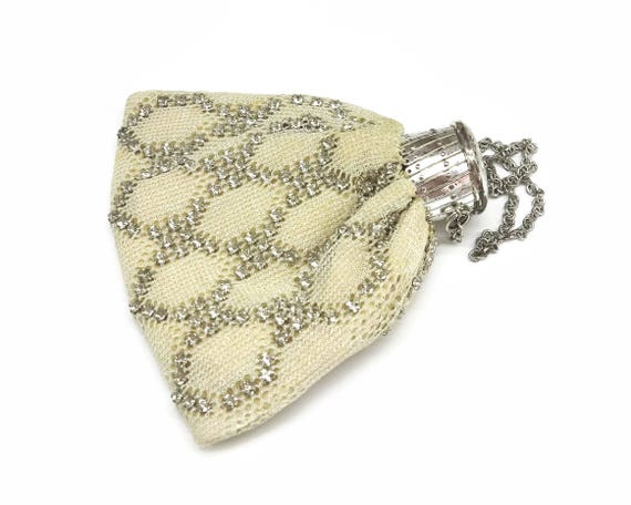 Vintage accordion topped rhinestone purse with beige metallic fabric and lattice rhinestone patterm, mid 20th century