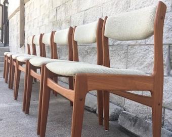 Set of six Danish teak and tweed dining chairs.