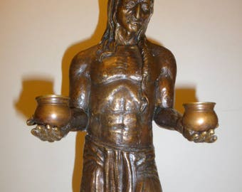 Large bronze sculpture of a Native American holding pots circa 1950s