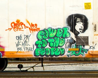 Power to the People: Train are, graffiti. Frame not included. Individually photographed and printed by Frank Heflin
