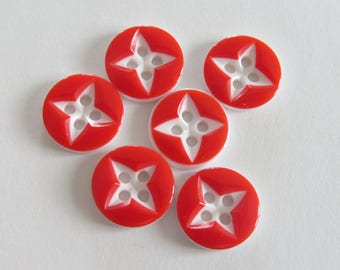 Red and white button with star pattern