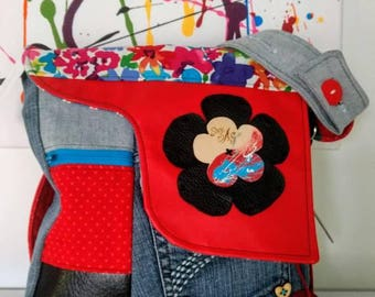 Red handbag with floral pattern of creation by bag