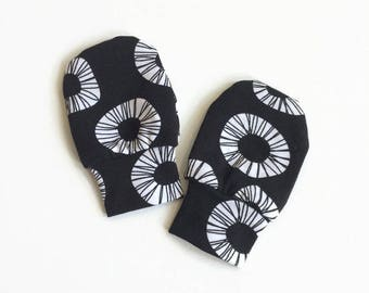 Black baby mittens, baby scratch mitts. Jersey cotton knit with white circular pattern. Baby Gift Girl Hand Covers. Organic cotton