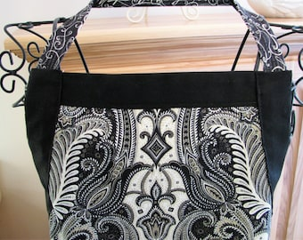 7584 Women's full apron with pocket & adjustable drawstring. 100% cotton. Black and Off-White scroll pattern with piping and rickrack trim.