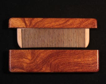 Wooden comb in the case of Tachy