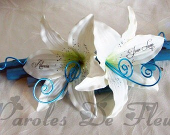 Wearing turquoise bamboo wedding band and white lily like to customize