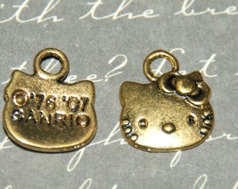3 Golden Cat Head charms childlike 13x11mm