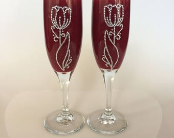 Unique decorative flute glasses. Both are Two-Sided with a leaf and flower design, front and back. Rhinestones glued on one by one.
