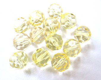 11 ROUND BEADS HAS FACETED YELLOW 10 MM