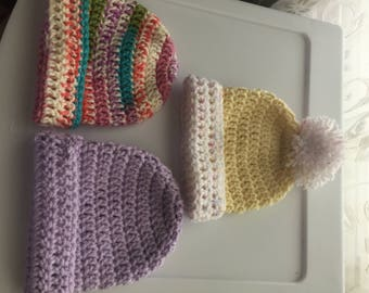 Homemade pastel crochet baby hats