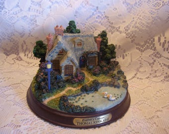 """Thomas Kinkade Lighted """"Everett's Cottage"""" on Wood Base"""