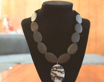 Necklace with brown beads and white and black marbled bead