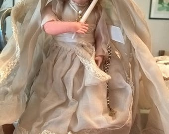 Antique Doll with her veil and his sword