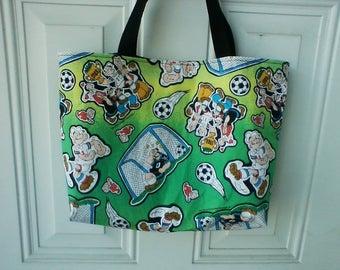 Popeye playing soccer tote bag