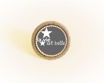 Adjustable silver ring and cabochon life is beautiful with star