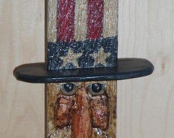 Primitive Uncle Sam carved from reclaimed fence rail