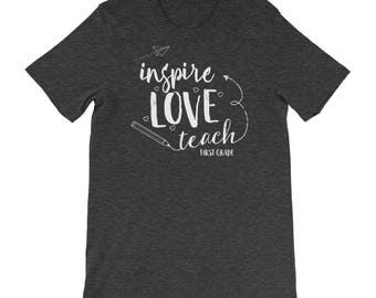 "First Grade ""Inspire Love Teach"" Teacher Tshirt | Super-Soft, Heathered, & Distressed | Elementary | School Spirit | Team Shirt"