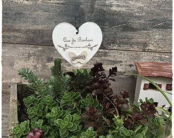 Wooden heart with white patina on rod iron with decorative ceramic