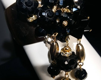Brass cuff, jet crystal and glass beads, beaded on wire. Chic evening wear