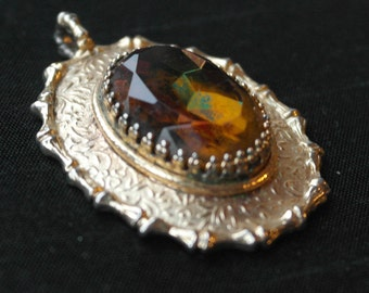 Large oval pendant set with oval amber coloured stone by Sarah Coventry