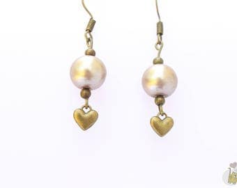 Bronze dangle earrings adorned with pink beads and a heart charm