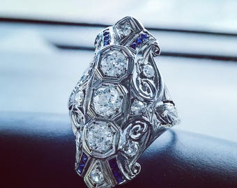 Platinum diamond and sapphire statement ring