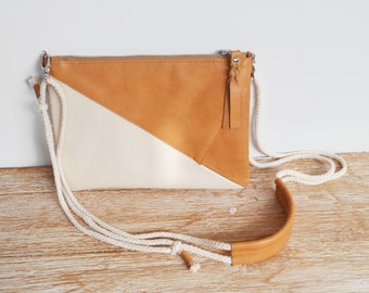 """PANTAI"" Tan and ivory leather clutch"