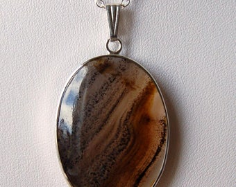 Transparent Montana agate with speckled brown and black banding - Montana. USA - 10