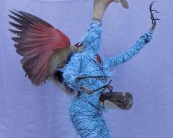 Mermaid cardinal Bird fairy demon taxidermy sculpture fantasy doll, holds child of viper snake