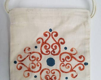 Coin Pouch With Design in Burnt Orange and Blue.