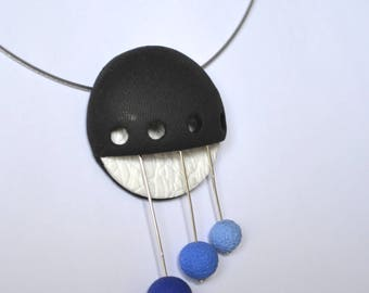 The Choker necklace with Pendant in embossed black, white and blue beads made of polymer clay