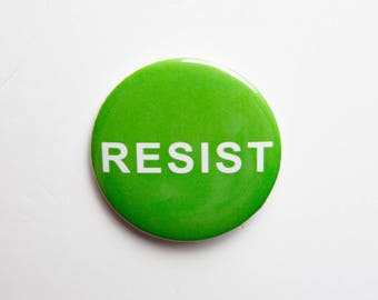 2 1/4 inch pin / button RESIST with a Green background