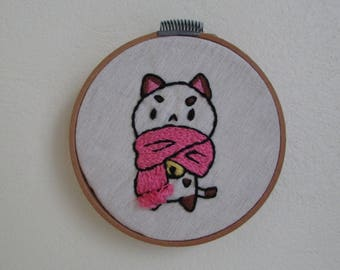 "Frame with handmade embroidery ""Puppycat with cold"""