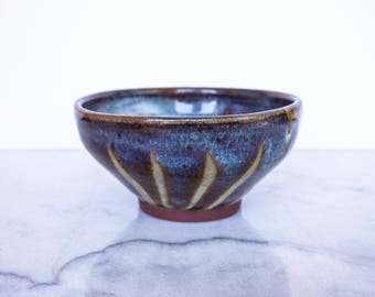 Small stoneware bowl handcrafted with gestural wax-resist decoration