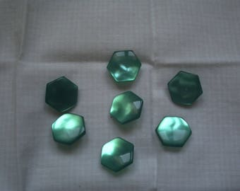 7 emerald green button with a hexagonal shape