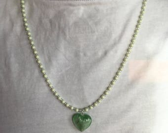 Delicate light green beaded necklace with green glass heart attachment