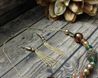 Handcrafted golden tassel earrings and chunky bead golden and emerald necklace