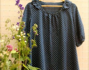 Blue blouse with polka dots