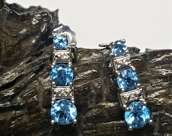 14 Karat White Gold Blue Topaz & Diamond Studs