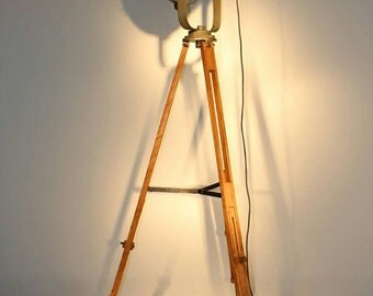 Hand made large tripod lamp, perfect match of the old stadium reflector and our wooden stand is compulsory piece in the industrial interior