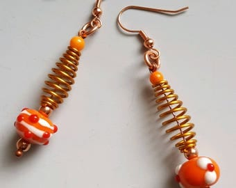 Funky orange glass beads, copper beads, gold aluminum swirls, on copper ear wires