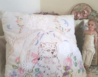 upcycled cat cushion, appliqued antique doilies, fluffy brown cat, lace flowers, ribbonwork sequins, 50s cat doily