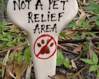 Not a pet relief area garden marker.