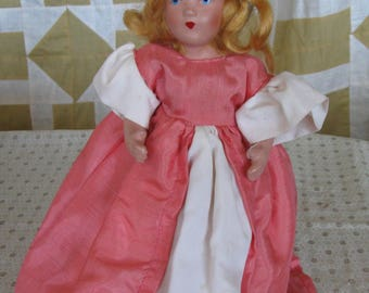 Vintage Bisque Dressed In Pink Jointed Doll