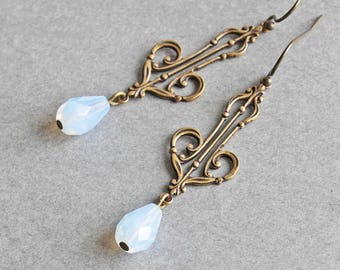Long Antiqued Brass Filigree Dangle Earrings with Pale Light Blue Teardrop Beads